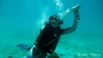 Divemaster Rommel taking a drink from a bottle he found