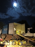 Loading the first truck under the moonlight