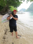 Chef Demi of Lagen Island Resorts proudly hauling away his finds for the afternoon.