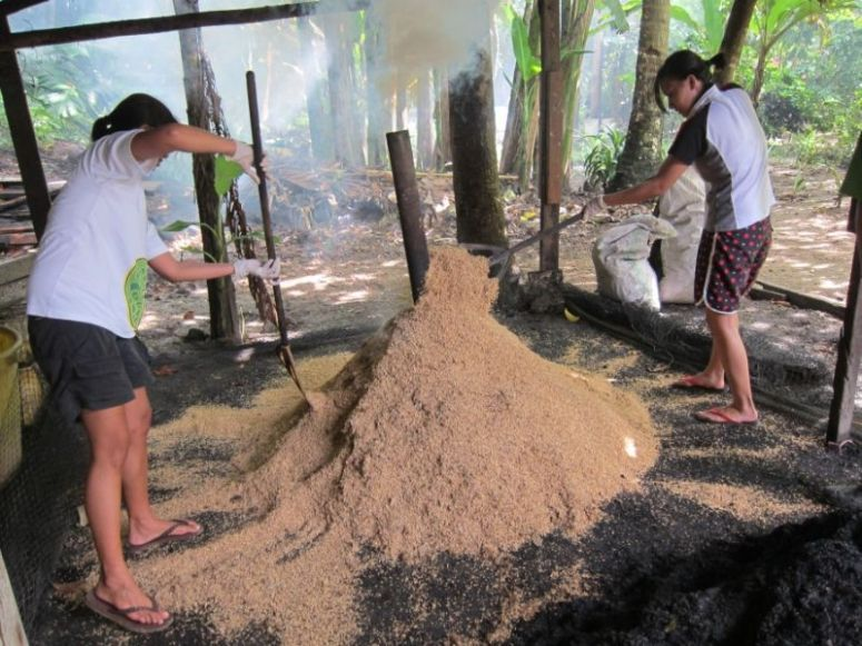 Mixing up the rice hulls for even carbonization