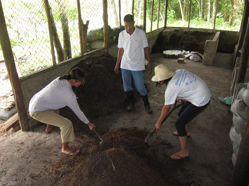 Mixing up the soil mix of cooked soil, vermicompost, and carbonized rice hull. Kuya Robert is boss.