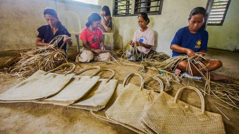 The complimentary buri bags are woven by the Buri Pandan Weavers' Association, a 66 member-strong women's group that started off with just three members in 2003.