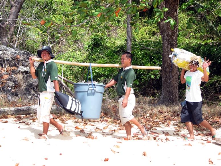 04 staff hauling trash