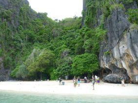 The staff clean up Shimizu Island, a popular picnic spot for guests from El Nido town.