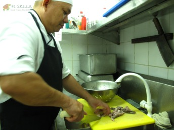 Kuya Francis preparing Booby's natural food – fish and squid!