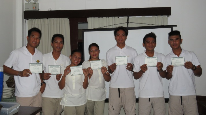The marine sports guides and guest activity coordinators of El Nido Resorts Apulit Island presenting their NI certificates, a proof of their hard work.