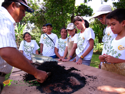 Kuya Henry mixing the compost that we produce onsite